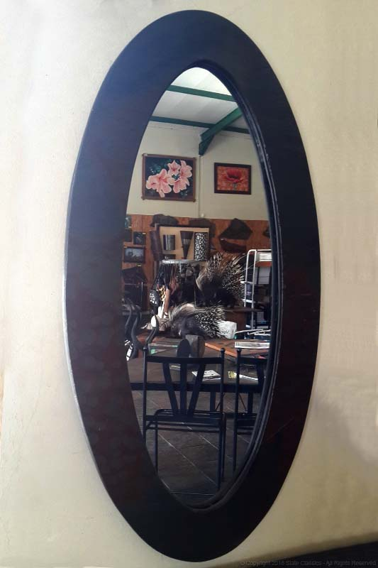 Oval mirror in a slate frame