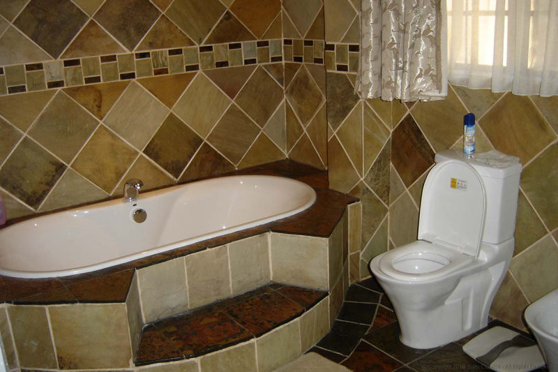 Sandstone & Mosaic tiles in a bathroom