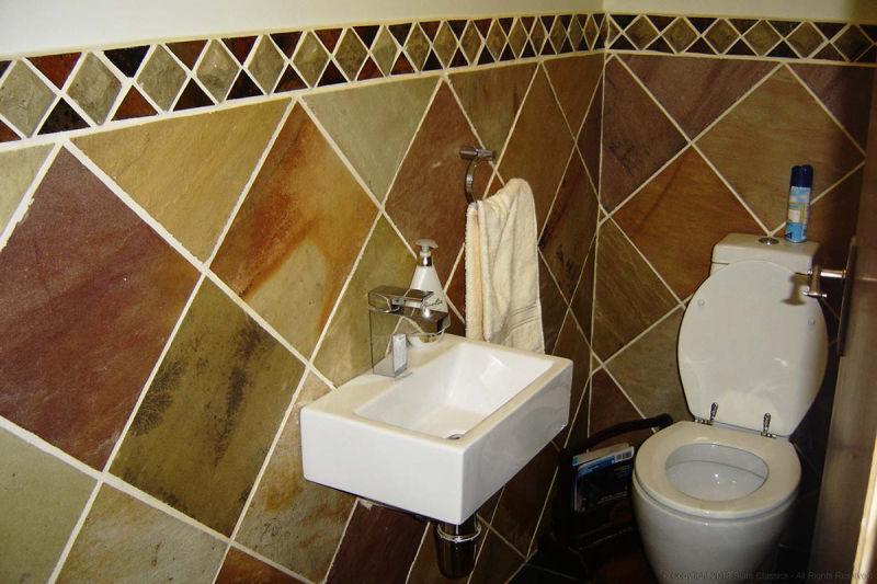 Sandstone & mosaic tiles in a Loo