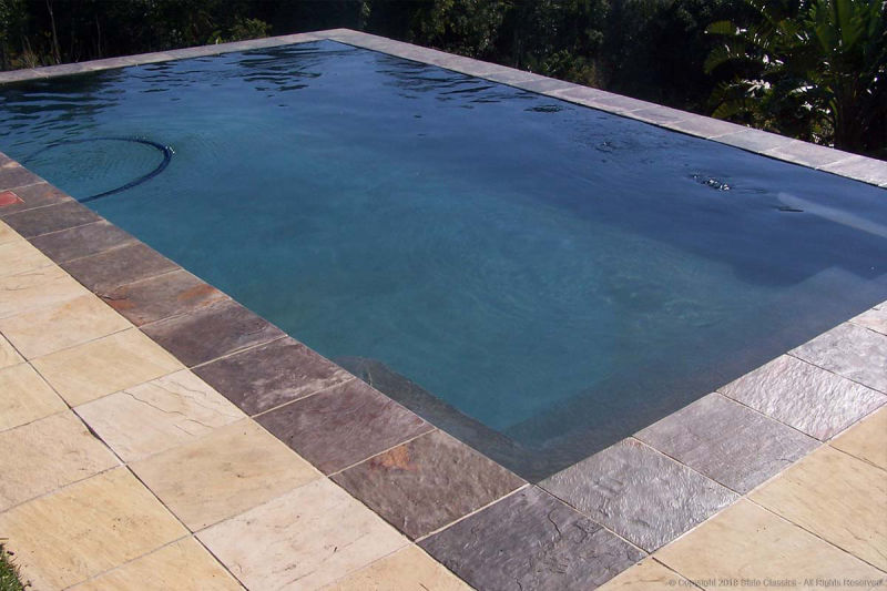 Sandstone tiles around a swimming pool
