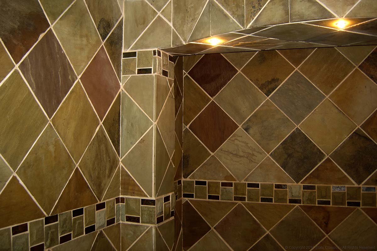 Sandstone & Mosaic tiles on a wall